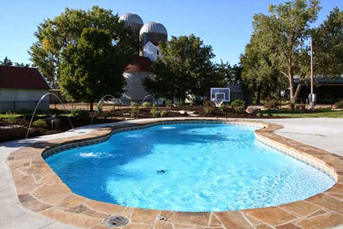 Swimming pool contractor nebraska for Sports pool designs